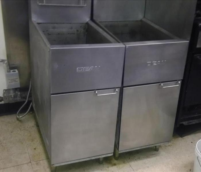 Fryer machine in commercial kitchen After