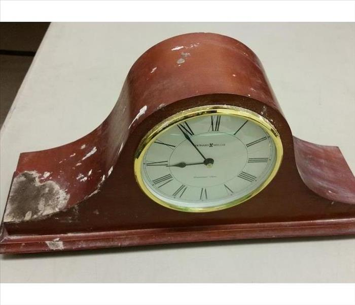 Mantle clock with fire damage