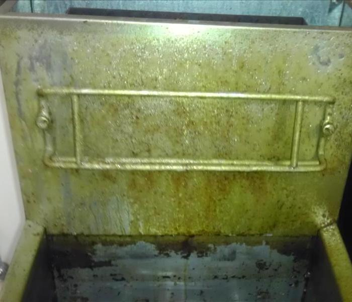Fryer machine in commercial kitchen Before
