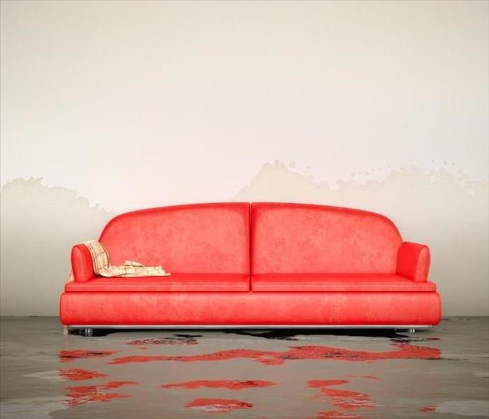 red couch in water damaged room